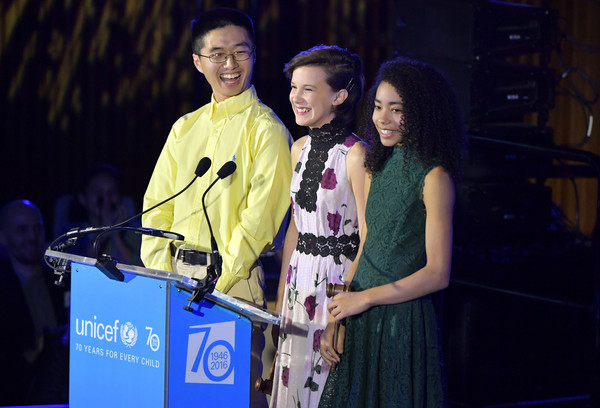 Akira presenting at UNICEF's 70th Anniversary Event with Chen Lin and Millie Bobby Brown. Photo Credit: Zimbio.com