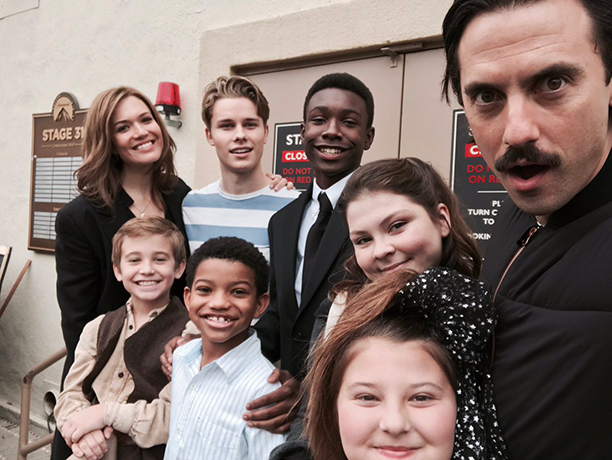 Niles with his castmates - Back row: Mandy Moore (Rebecca), Logan Shroyer (15 year old Kevin), Niles, Hannah Zeile (15 year old Kate), Milo Ventimiglia (Jack) Front row: Parker Bates (9 year old Kevin), Lonnie Bates (9 year old Randall), Mackenzie Hancsicsak (9 year old Kate)